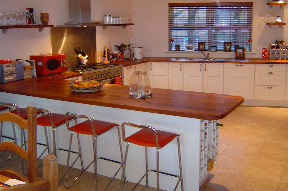 White Classic Kitchen_Shaker_Oak Countertop_Built in wine rack_Island seating_Robert Mooney Furniture_South Dublin_North Wicklow